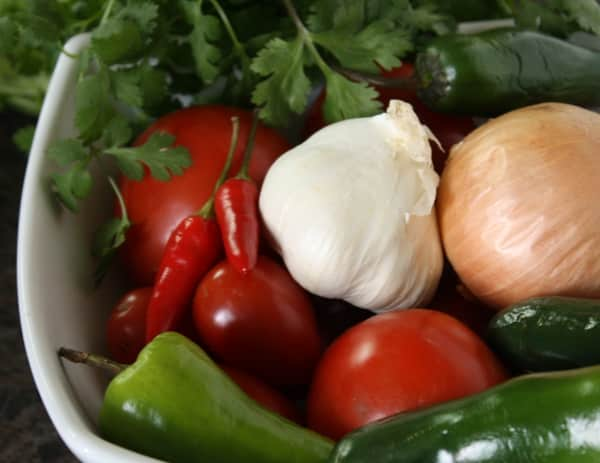 a basket of all the ingredients for making sofrito