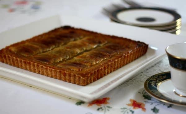 tarte aux pommes French apple tart baked on a white plate