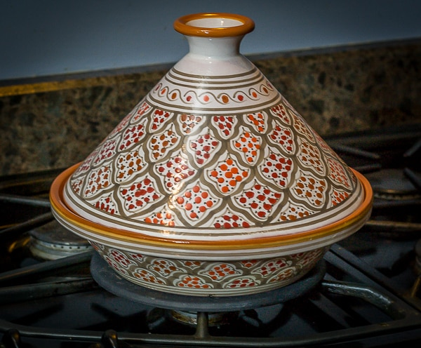 a red and orange tagine on a stove