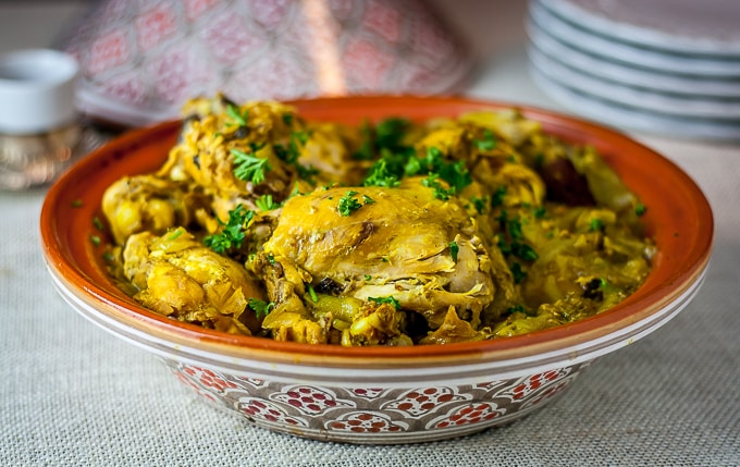 a tagine filled with moroccan saffron chicken and parsley