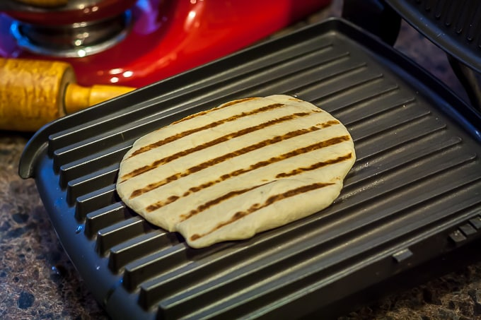 naan on an indoor grill with grill marks on top