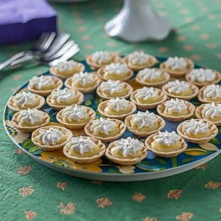 Mini lemon tartlets: lemon curd filling and whipped cream topping. | ethnicspoon.com