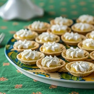 Mini lemon curd tartlets with whipped cream. | ethnicspoon.com