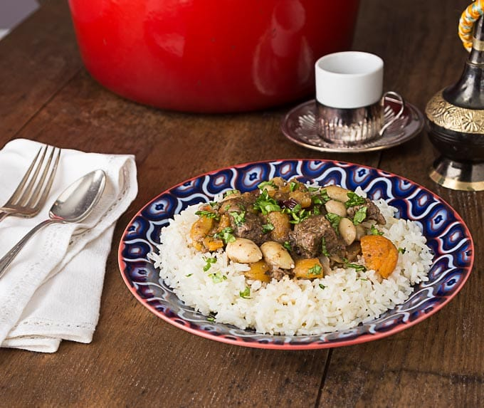 Find out how to make a Middle Eastern lamb stew with apricots, almonds, cherries and rose water | ethnicspoon.com