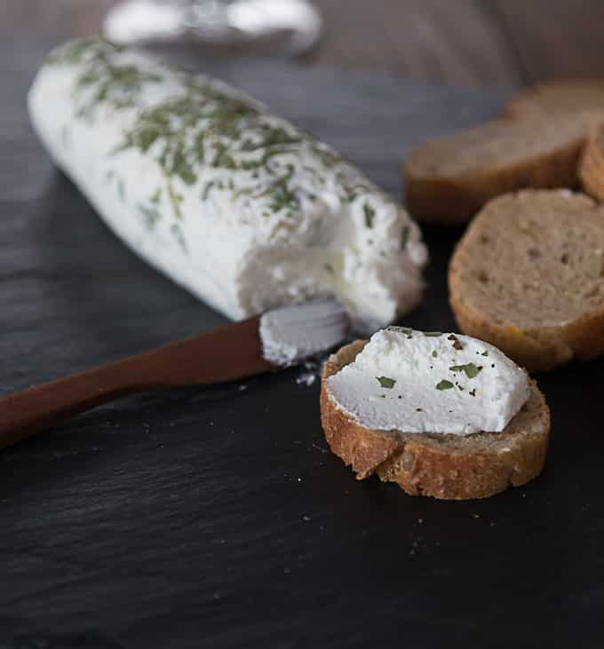 Find out how to make goat cheese or chevre at home. This is an easy DIY homemade goat cheese with tarragon. | ethnicspoon.com