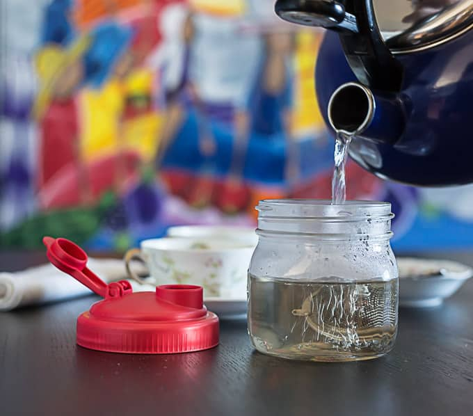 Rose hips tea steeping with teapot and reCAP mason jar flipcap | ethnicspoon.com