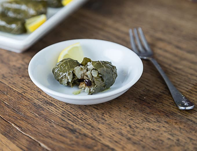 Dolmades recipe with rice, onions, currants and parsley.   ethnicspoon.com