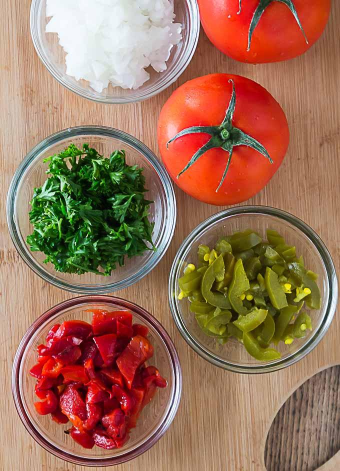 the ingredients to make turkish salsa in separate bowls