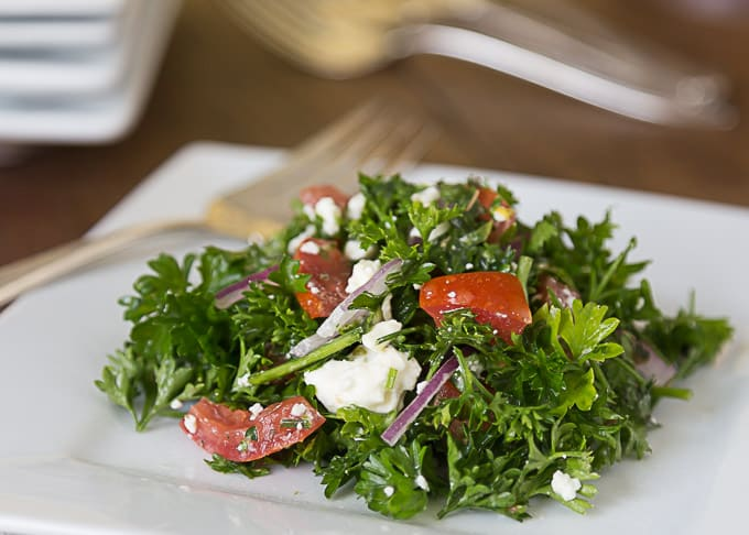 a closeup mediterranean parsley salad with a fork behind
