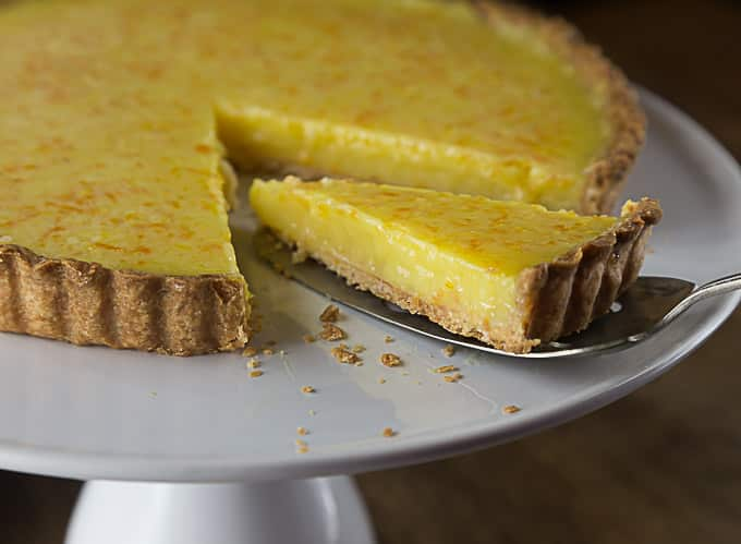 The perfect lemon tart for your next gathering. A great combination of sweet, tart and creamy filling with a nice crunchy short crust. | ethnicspoon.com