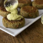 Try a healthy burger with amazing flavors! Spicy curry lentil burgers with a creamy rich avocado yogurt sauce kicked up with a little chili powder. #vegetarian   ethnicspoon.com