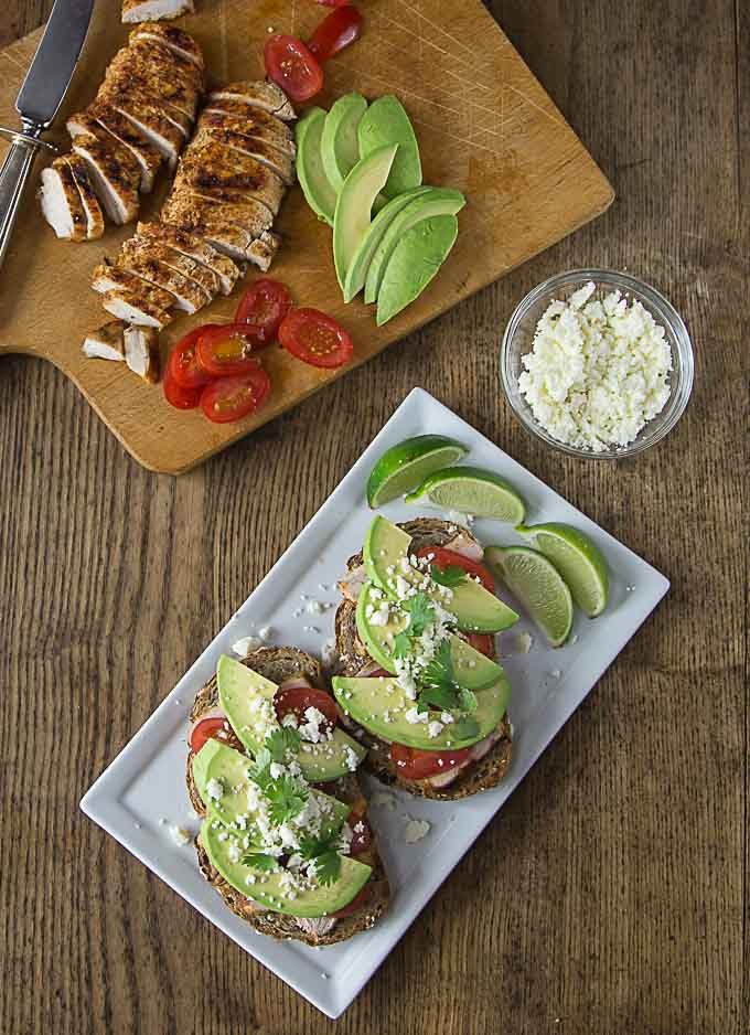 Try a delicious open face avocado chili lime chicken sandwich. This has a nice combination of spicy & tangy with creamy smooth avocado. Sprinkle on some queso fresco too! | ethnicspoon.com