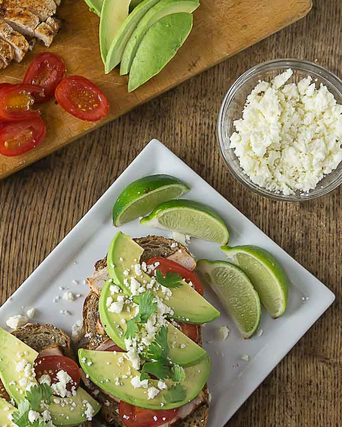 Try a Latin style open face sandwich. Layer some chili lime chicken with avocado, tomatoes and queso fresco for a tasty meal! | ethnicspoon.com
