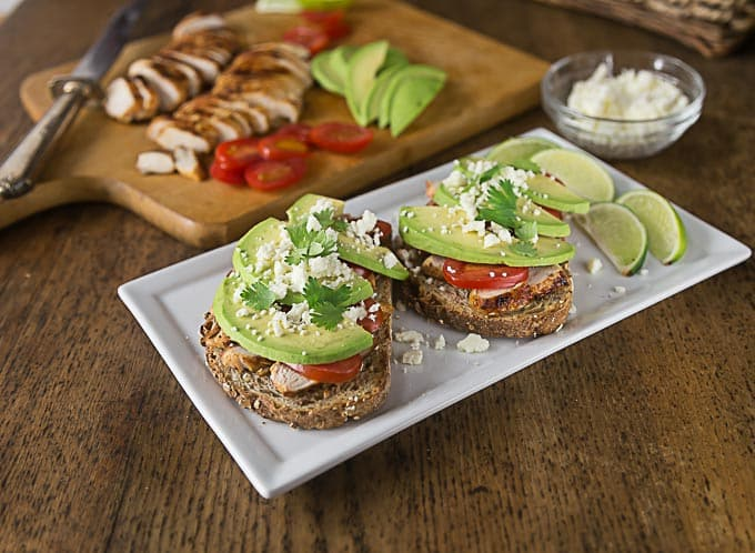 Try a Latin style open face sandwich. Layer some chili lime chicken with avocado, tomatoes and queso fresco for a healthy lunch or dinner! | ethnicspoon.com