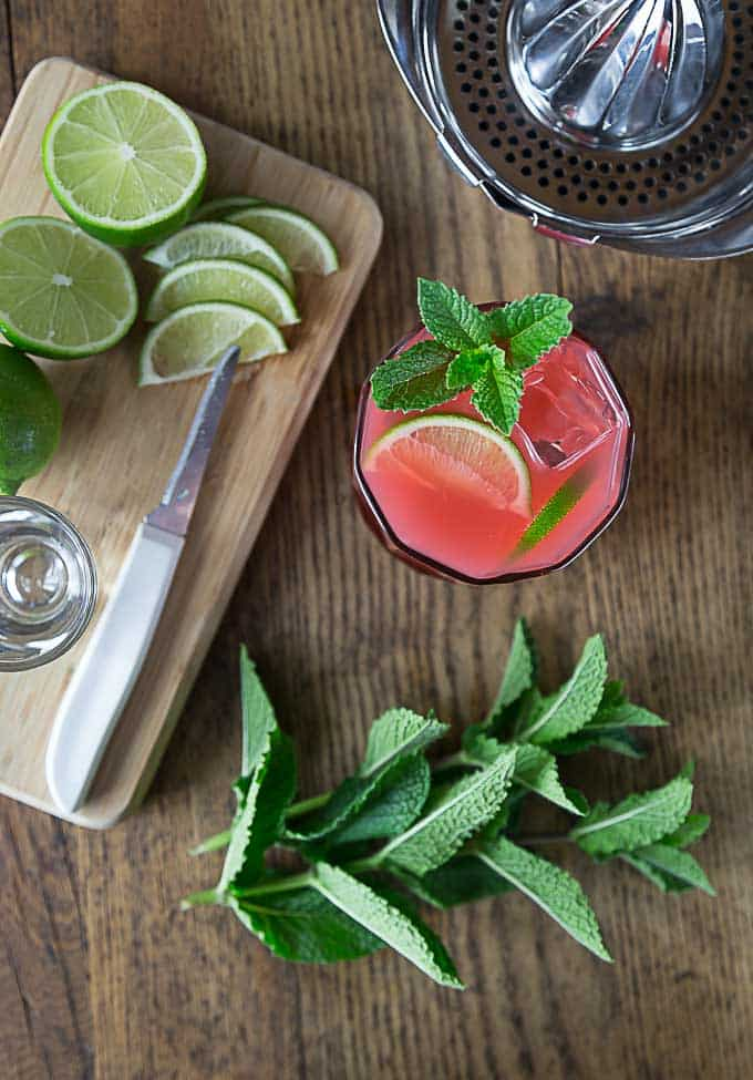Sip a cool guava and lime cocktail with a hint of mint. Squeeze some limes, add tequila and guava juice and a sprig of mint! Simple and delicious | ethnicspoon.com
