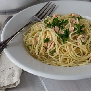 A rich creamy sauce with salmon, dill and angel hair pasta with a little cayenne kick! This pasta is AMAZING! A quick and easy weeknight meal too! So Good! | ethnicspoon.com