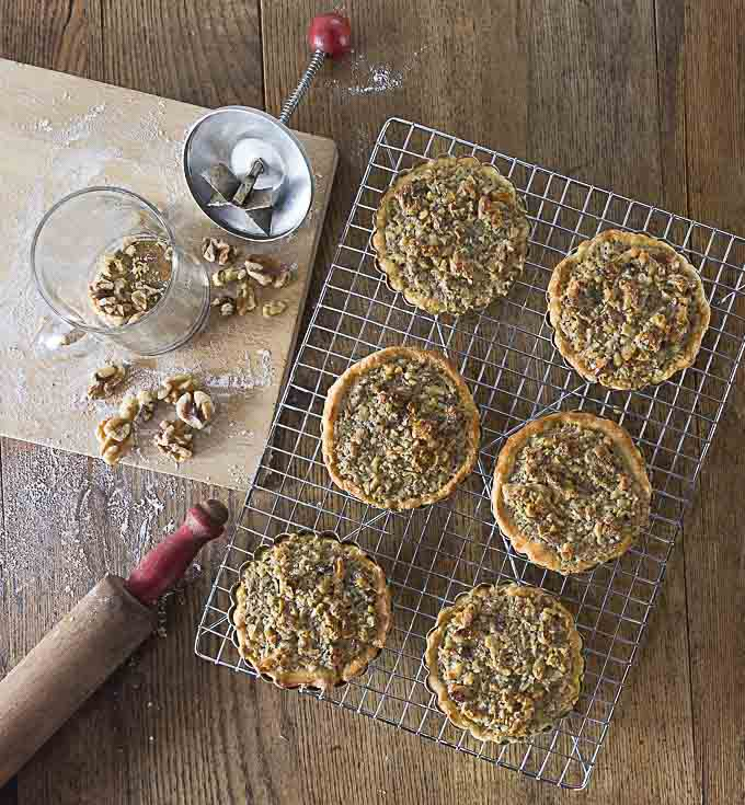 Amazing Tartelettes au Noix! French walnut tartlets are crunchy and creamy caramelized filling with a hint of orange and similar to pecan pie. You will love these little beauties and they are fun to make! | ethnicspoon.com
