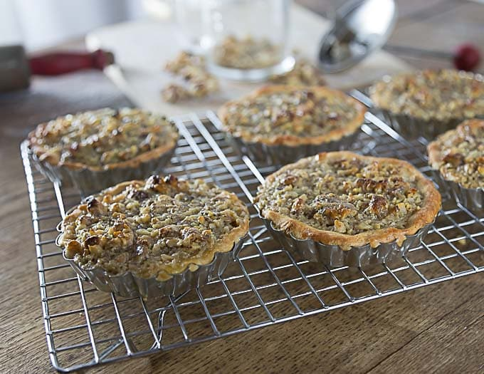 You will love these Tartelettes au Noix! French walnut tartlets are crunchy and creamy caramelized filling with a hint of orange and similar to pecan pie. | ethnicspoon.com