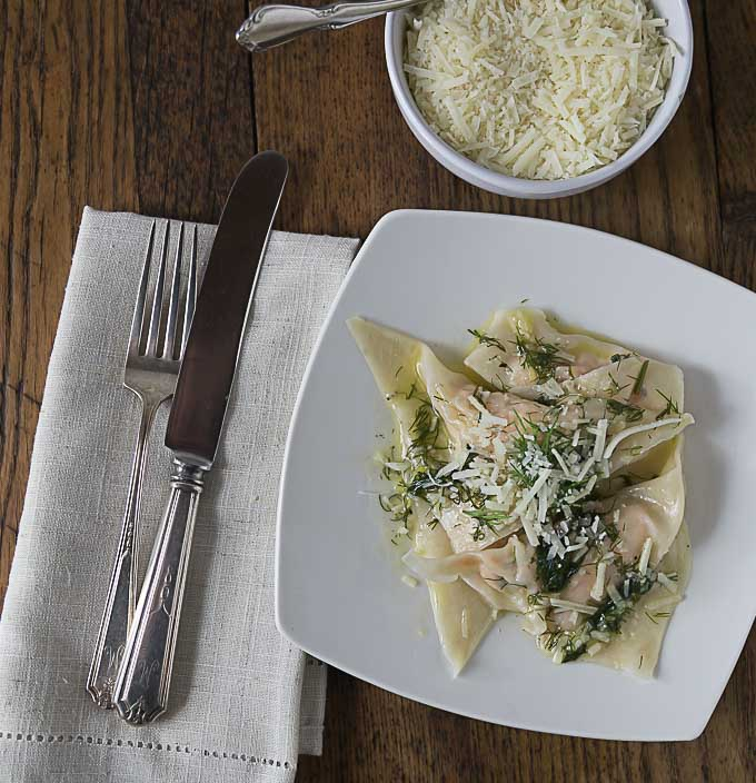 Quick and easy salmon ravioli made with wonton wrappers. You'll love this time saving recipe and serve it with a simple lemon dill white wine sauce.   ethnicspoon.com