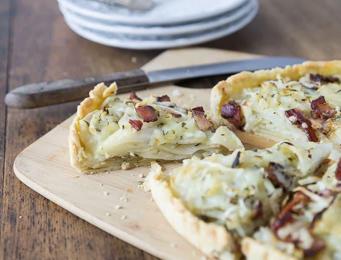 layers of a potato bacon gruyere tart