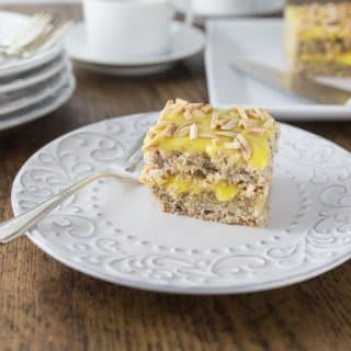 Try this Swedish almond cake with you next cup of coffee! Light and airy Swedish almond cake makes a wonderful dessert your family will love! A nice meringue is folded into ground almonds and flour. Once it is baked you add a creamy almond custard like filling and topping. | ethnicspoon.com