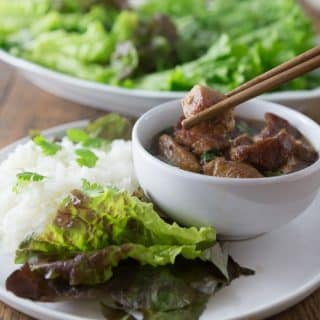 Traditional Vietnamese Thit Kho Tau, braised pork in coconut sauce. Tender and delicious in a light sauce. | ethnicspoon.com