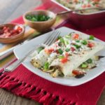 Need an easy weeknight meal? Try these easy chicken enchiladas with spicy jalapeno white queso sauce! I love spicy cheese sauce! Que rico! You can make these ahead of time and freeze. Pop it in the oven and it's ready in about 30 minutes. Bonus! | ethnicspoon.com