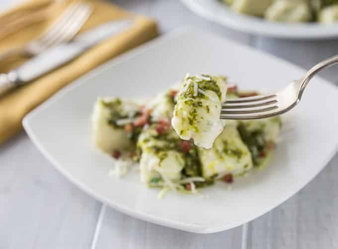 Homemade gnocchi anyone? It's really simple and delicious! Try this creamy and rich ricotta gnocchi with a nice lemony arugula pesto and tasty salty bits of pancetta! Everything is better with bacon right? The texture of the gnocchi has a nice firm outside and soft cheesy middle. This is a must try recipe. Buon appetito! | ethnicspoon.com