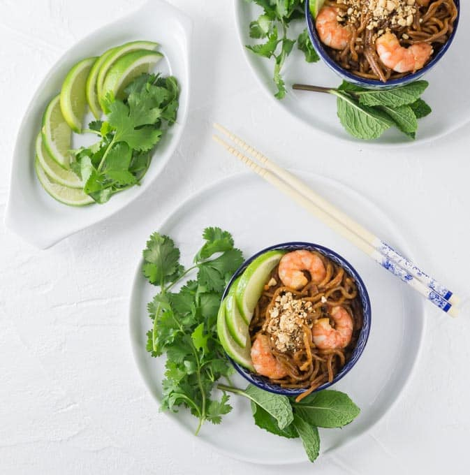 Super easy shrimp pad thai can be ready in about 5 minutes! This is a fast weeknight meal. Add some fresh cilantro, limes and chopped peanuts! So Good! | ethnicspoon.com #sponsored #ad