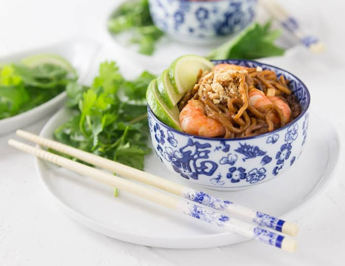 Super easy shrimp pad thai can be ready in about 5 minutes! This is a fast weeknight meal. Add some fresh cilantro, limes and chopped peanuts! So Good! | ethnicspoon.com