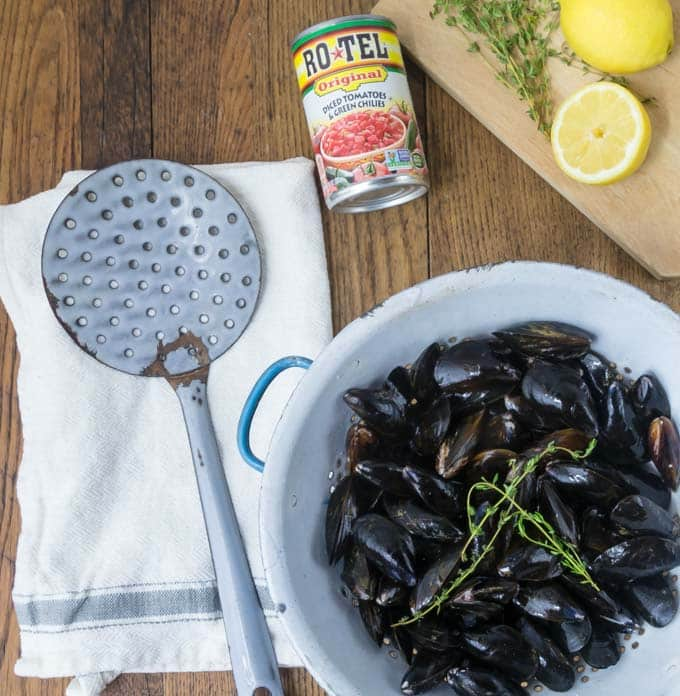 Have this as appetizer or make it a meal! Grab some crusty bread and dip into this spicy sauce! Tender and tasty mussels in a spicy tomato broth will rock your tastebuds! This recipe comes together really quick too! You will be soaking up every drop! The secret ingredient: spicy RO*TEL tomatoes and chiles to kick it up a notch! | ethnicspoon.com