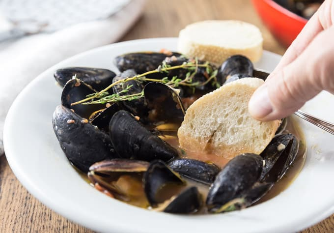 Like mussels? You have to try this recipe. Tender and tasty mussels in a spicy tomato broth will rock your tastebuds! This recipe comes together really quick too! Dip in a nice crusty bread and you will be soaking up every drop! The secret ingredient: spicy RO*TEL tomatoes and chiles to kick it up a notch! | ethnicspoon.com