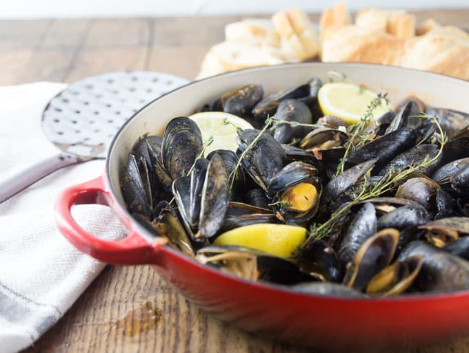 Grab some crusty bread and dip into this spicy sauce! Tender and tasty mussels in a spicy tomato broth will rock your tastebuds! This recipe comes together really quick too! You will be soaking up every drop! The secret ingredient: spicy RO*TEL tomatoes and chiles to kick it up a notch! | ethnicspoon.com