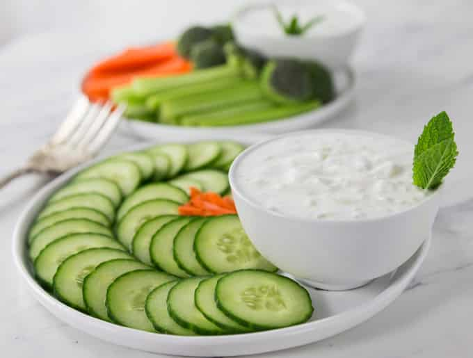 How about a nice Greek salad? One sauce you need to make for a tasty spicy dip: Tzatziki. This has a nice smooth, creamy, garlic flavor to add to many dishes like grilled meats like kebabs or lamb chops, salads and veggie trays to name a few. Authentic Greek Tzatziki uses a smooth Greek yogurt, cucumber, garlic, dill and some olive oil. | ethnicspoon.com