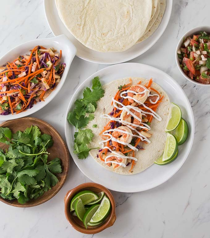 Tacos anyone? Here is an easy recipe for spicy shrimp tacos with jicama slaw for your next taco Tuesday! This recipe comes together very quick so it's a must try for a fast weeknight meal too! | ethnicspoon.com