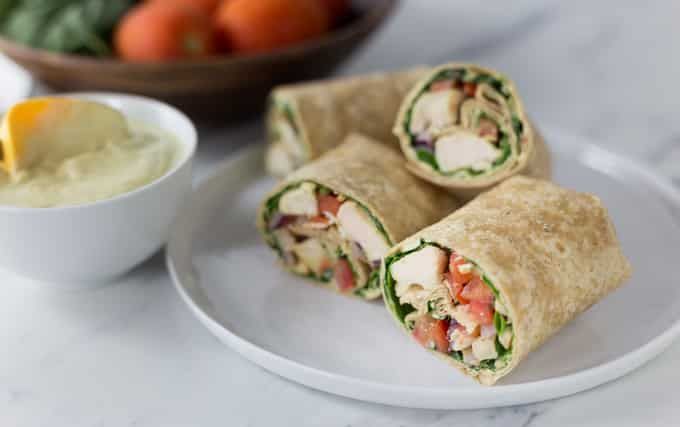 Try a spicy new wrap! Creamy and spicy curry chicken salad wrap add a bit of ethnic flair to your lunch or dinner. You can also slice these narrow and serve as an appetizer too! The secret sauce: a bit of my homemade curry blend whipped into some Greek yogurt. This is a really healthy recipe wrapped in a large flour tortilla! | ethnicspoon.com