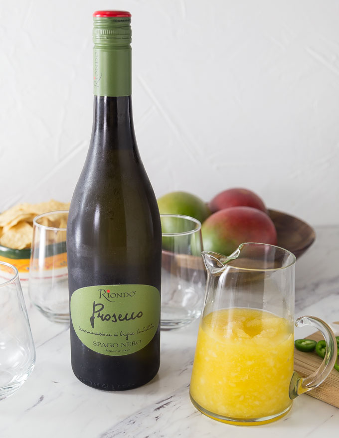 Try a tropical and refreshing sparkling mango cocktail with Riondo Prosecco and a slice of jalapeno for a nice spice note!   ethnicspoon.com