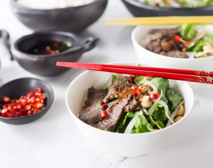 two bowls of pho tron with colored chopsticks