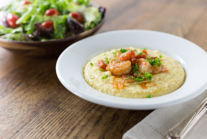 Try a bowl of comfort food with a Southern tradition! Shrimp and grits is true Lowcountry cuisine from coastal Carolina and Georgia. Imagine a spicy saucy shrimp with some creamy corn grits with cheese for a nice balance of flavor. This is a must try recipe and feel free to get creative. The grits are a blank canvas to add something spicy to. Like cajun flavors? Add some spicy cajun style shrimp. | ethnicspoon.com