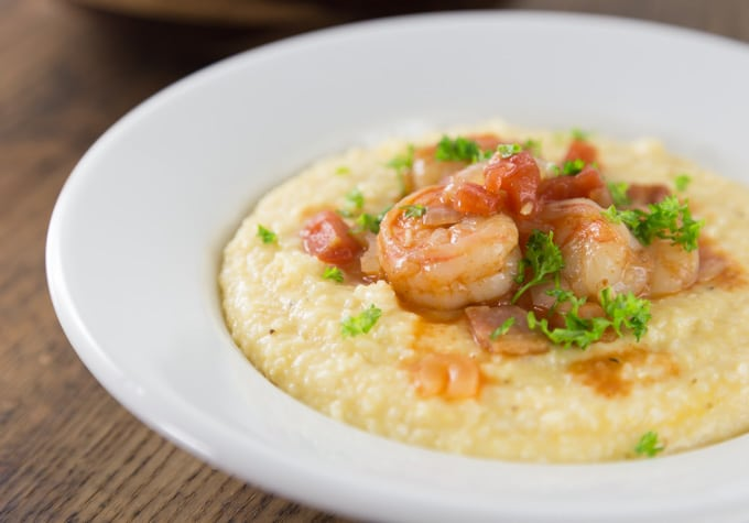 a bowl of shrimp and grits close up