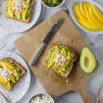 Try a new avocado toast recipe with Latin flair! Creamy avocados with tangy mango, salty queso fresco and a sprinkle of chili powder. The combination of flavors is incredible! | ethnicspoon.com