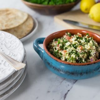 The is a very refreshing and healthy salad you will often find at Middle Eastern restaurants. Here is a really simple recipe for an authentic tabouleh made with cracked bulgur wheat, parsley, tomato, feta, mint, lemon juice and onion. There is some variation on the spelling of tabbouleh or tabouli, no matter how you spell it you will love this salad with it's fresh flavors! | ethnicspoon.com