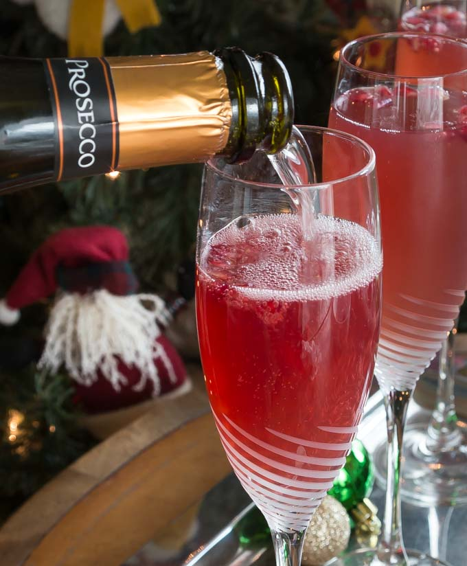 Here is a great brunch cocktail you will love! Try a crisp and refreshing prosecco pomegranate mimosa! Sparkling bubbly prosecco with a splash of tang pomegranate is a tasty combination for this libation. | ethnicspoon.com