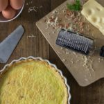 Quiche Lorraine is a slice of goodness and you will love the flavor! This is a dish for all meals: breakfast, brunch, lunch or dinner. This has such a rich custard like texture with a salty cheese and bacon flavors what is not to love! Simple ingredients of eggs, bacon, cream and cheese that come together in a crispy crust. | ethnicspoon.com