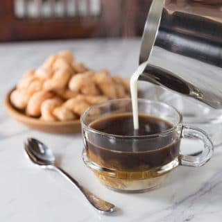 If you like flavored coffee with a tropic twist you have the try Vietnamese coconut coffee. Vietnamese coconut coffee is a super simple coffee drink to make at home and it is the authentic version made in Hanoi at popular coffee shops. Drizzle in a combination of sweetened condensed milk and coconut cream on top of a strong brewed coffee. | ethnicspoon.com
