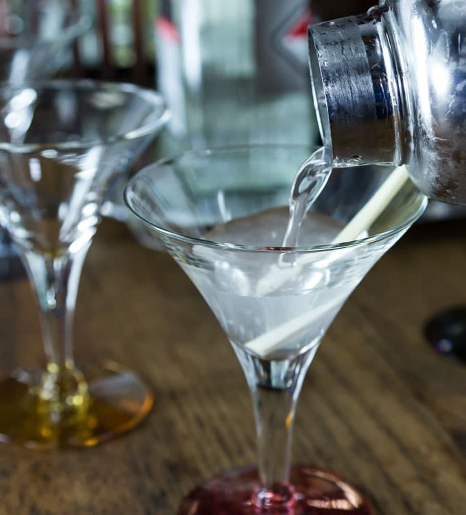Lemongrass vodka martini adds a fresh lemon flavor to a popular cocktail. Shake up a vodka martini with a Southeast Asian twist. Learn preparation techniques to use lemongrass in several different dishes. This drink uses lemongrass infused simple syrup and it adds a subtle flavor. | ethnicspoon.com