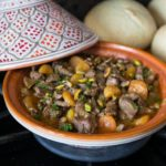 How about trying some exotic flavors in a really simple to make stew? Moroccan lamb tagine with its combination of sweet and savory flavors is one dish that is hard to resist and easy to make. You can make this in the slow cooker, dutch oven or tagine dish. | ethnicspoon.com
